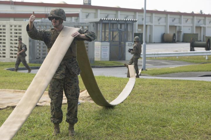 Walk the Line | Marines with Bulk Fuel Company assemble a fuel site [Image 1605]