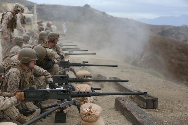 Marines with Company A, Infantry Training Battalion, School of Infantry-West (SOI-West), fire the M2A1 .50 caliber heavy machine gun as part of their basic infantry training at Marine Corps Base Camp Pendleton, Calif. The M2A1 is the Marine Corps' latest upgrade to the legacy M2 machine gun and enhances Marines' lethality and survivability on the battlefield. The M2A1 modernizes the M2 with major changes, including set headspace and timing, a quick change barrel, and flash hider that reduces the weapon's signature by 95 percent. (U.S. Marine Corps photo by Lance Cpl. Joseph A. Prado)