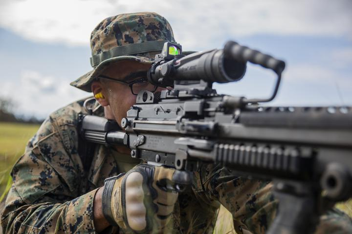 Lance Cpl. Markus Dodd sights in on a target with a M249 Light Machine Gun during a fire and movement range Oct. 24, 2018, at Camp Hansen, Okinawa, Japan. During the range, Marines with 3rd Marine Logistics Group practiced their marksmanship skills, improved their communication and worked on their weapons handling while engaging targets. Dodd is a native of Niles, Michigan, and is a machine gunner with the Tactical Readiness and Training, G-3, 3rd MLG Headquarters. (U.S. Marine Corps photo by Lance Cpl. Terry Wong)