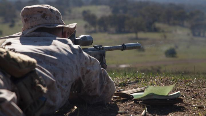 Cpl. John Luze, a competitor with the Marine Corps Shooting Team, fires a round with his M40A5 sniper rifle during a practice fire at Puckpunyal Military Area in Victoria, Australia, May 7, 2016. The Marine Corps Shooting Team traveled to Australia to compete in the Australian Army Skill at Arms Meeting 2016. The M40A5 is a bolt-action sniper rifle the Marine Corps uses for long-range enemy engagements.